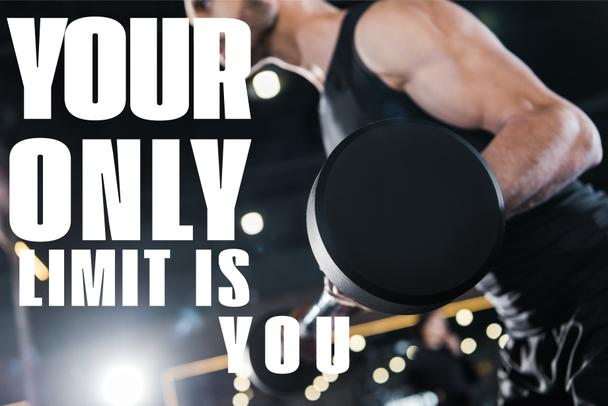 selective focus of strong man exercising with heavy barbell in gym with your only limit is you illustration - Photo, Image