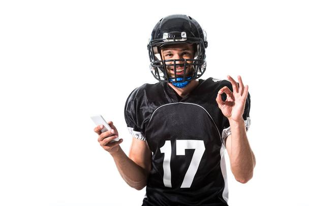 American Football player with smartphone and okay sign Isolated On White - Photo, Image