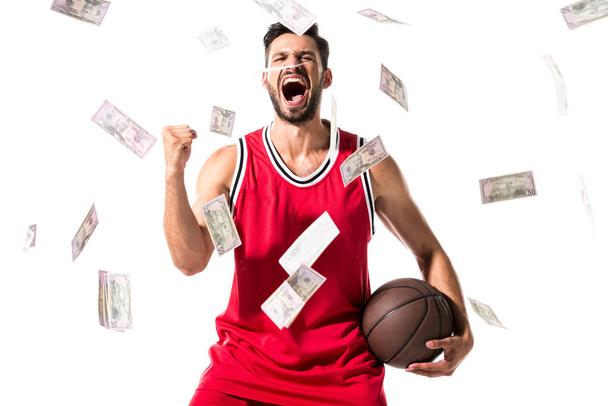 yelling basketball player Isolated On White with falling money - Photo, Image