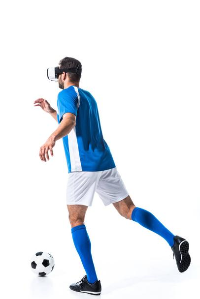 back view of soccer player in virtual reality headset training with ball Isolated On White - Photo, Image
