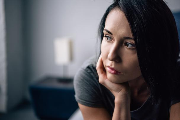 selective focus of beautiful depressed woman looking away at home - Photo, Image