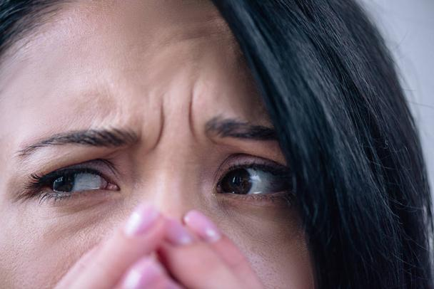 close up view of beautiful depressed woman covering mouth at home - Photo, Image