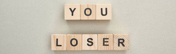 panoramic shot of wooden blocks with you loser lettering on grey background, bullying concept - Photo, Image