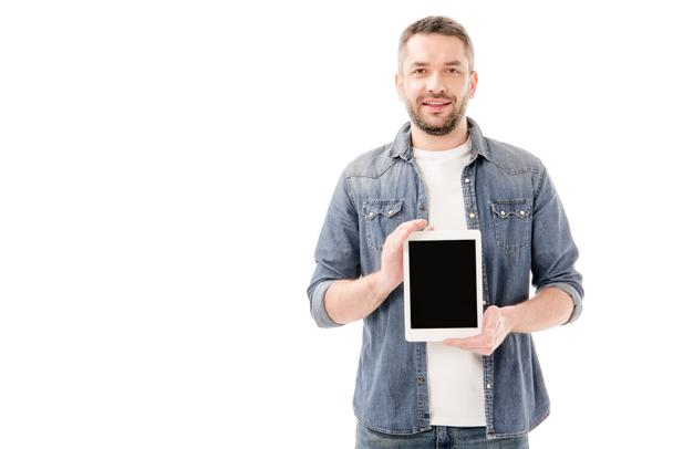 front view of smiling bearded man in denim shirt holding digital tablet with blank screen isolated on white - Photo, Image