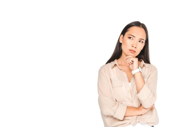 thoughtful asian woman holding hand near face and looking away isolated on white - Photo, Image