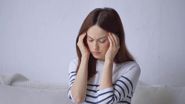 woman using smartphone and suffering from headache - Footage, Video