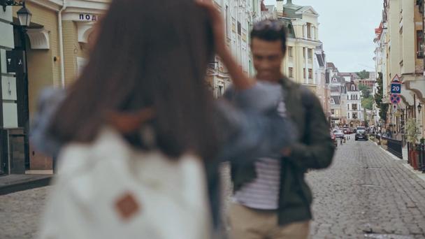 KYIV, UKRAINE - JULY 9, 2019: bi-racial man taking picture of his girlfriend - Footage, Video