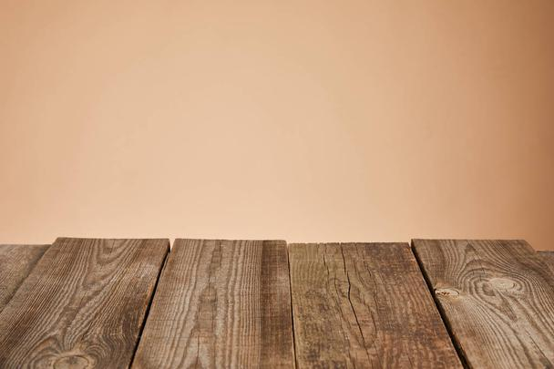 empty rustic wooden table isolated on brown  - Photo, Image