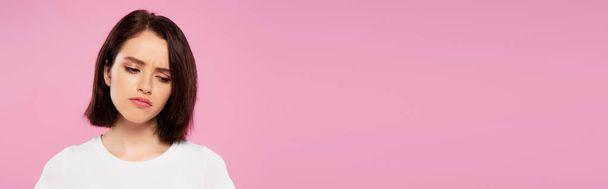panoramic shot of beautiful sad girl isolated on pink - Photo, Image