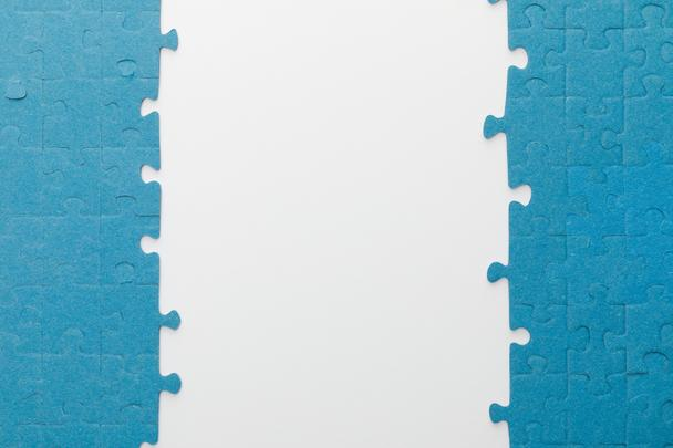 top view of blue jigsaw puzzle on white background - Photo, Image