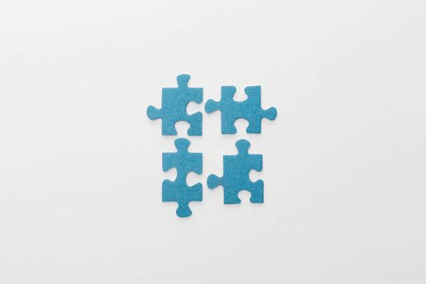 top view of pieces of blue jigsaw puzzle on white background - Photo, Image