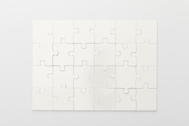 top view of completed jigsaw puzzle on white background - Photo, Image