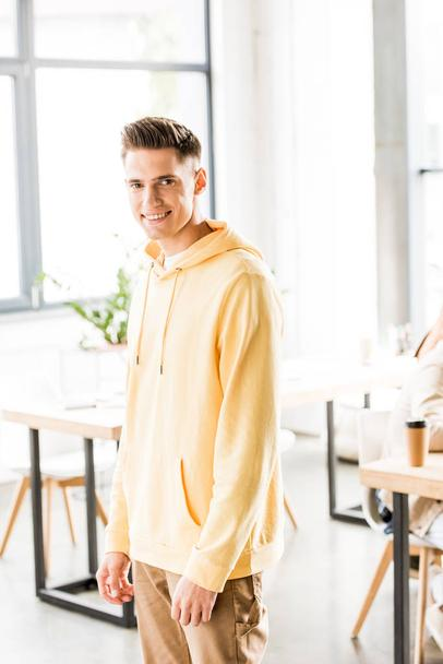 handsome young businessman in casual clothing smiling at camera  - Photo, Image