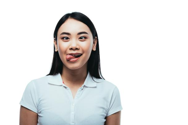 attractive asian girl showing funny grimace isolated on white - Photo, Image