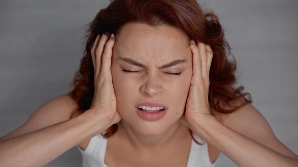 overhead view of woman screaming while suffering from headache - Footage, Video