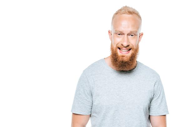 handsome smiling bearded man in grey t-shirt, isolated on white - Photo, Image
