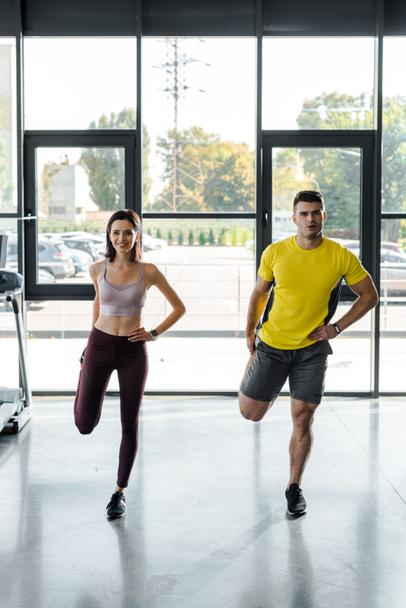 sportsman and sportswoman working out together in sports center - Photo, Image
