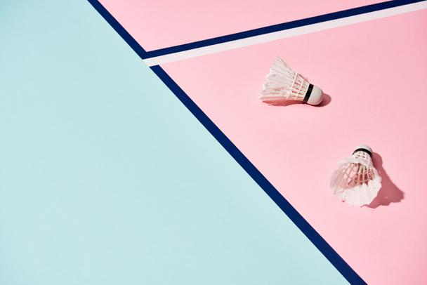 Badminton shuttlecocks on pastel surface with blue lines - Photo, Image