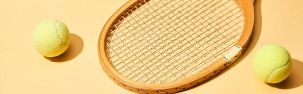 Wooden tennis racket and balls on yellow background, panoramic shot - Photo, Image