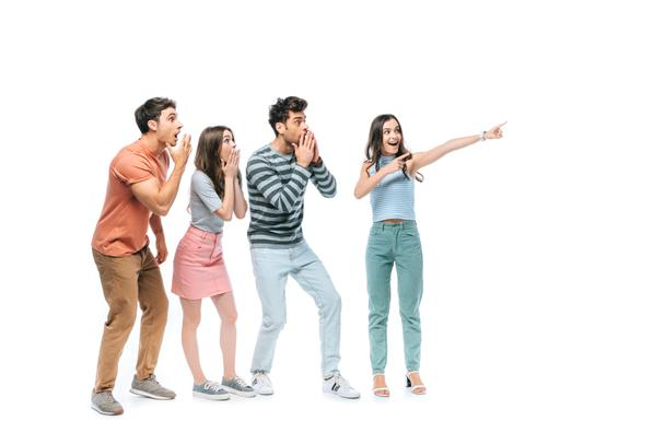 shocked friends pointing at something isolated on white  - Photo, Image