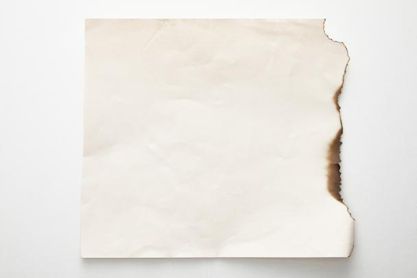 top view of empty burnt vintage paper on white background - Photo, Image