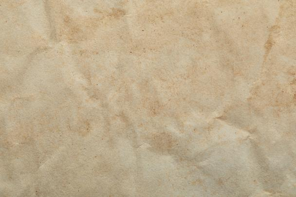 top view of crumpled vintage beige paper texture with copy space - Photo, Image