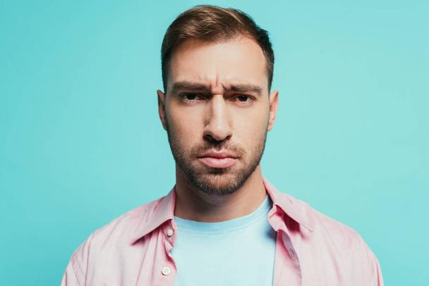 portrait of serious handsome man looking at camera, isolated on blue - Photo, Image
