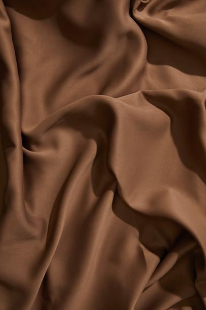 Top view of brown wavy tablecloth   - Photo, Image