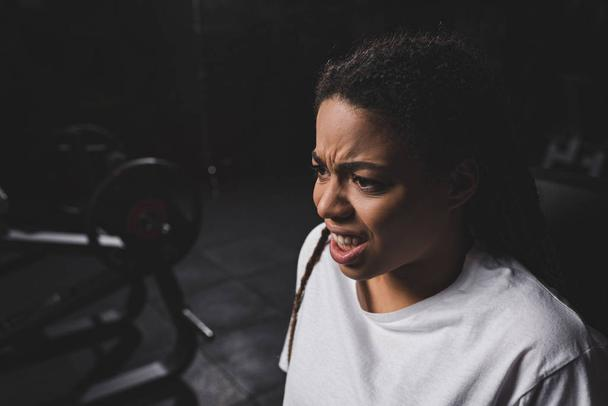 emotional african american woman working out in gym  - Photo, Image