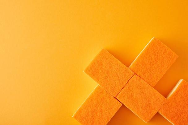 flat lay with sponges for house cleaning on orange - Photo, Image