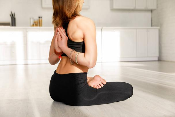 cropped view of girl in reverse prayer pose practicing yoga  - Photo, Image