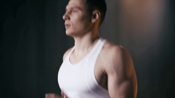 young sportive man running on treadmill in gym  - Footage, Video