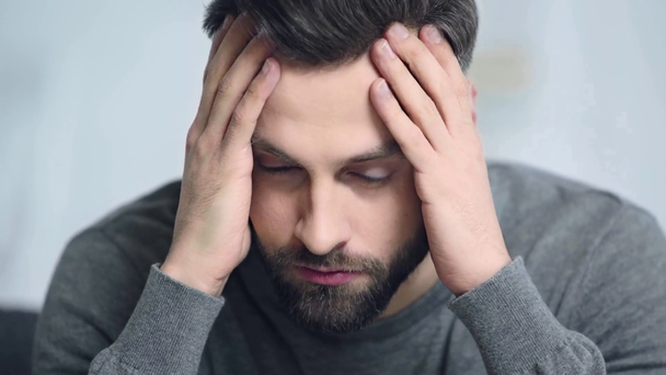 worried and bearded man touching face  - Footage, Video