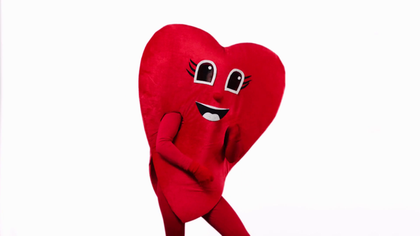 person in red heart costume dancing isolated on white - Footage, Video