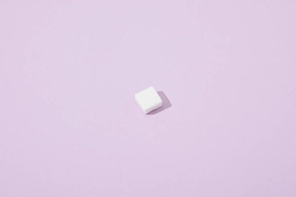 lump sugar cube on violet background with copy space - Photo, Image