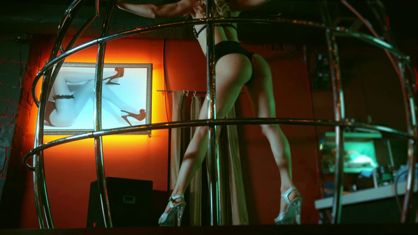 sexy young stripper in underwear dancing near metallic cage  - Footage, Video