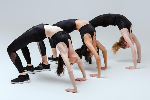 multicultural women doing bridge exercise on white  - Photo, Image