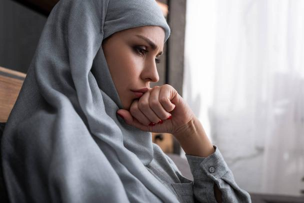 upset muslim woman in hijab with clenched fist, domestic violence concept   - Photo, Image