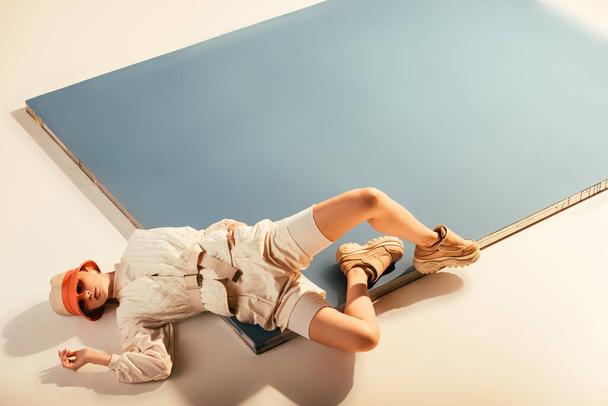 stylish model posing for future fashion shoot on beige and blue - Photo, Image