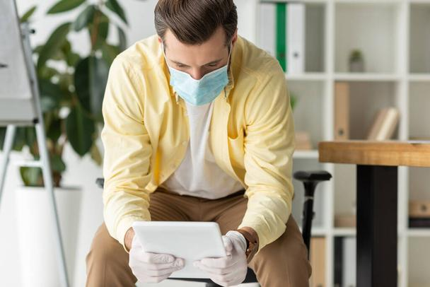 businessman in medical mask and latex gloves using digital tablet in office - Photo, Image