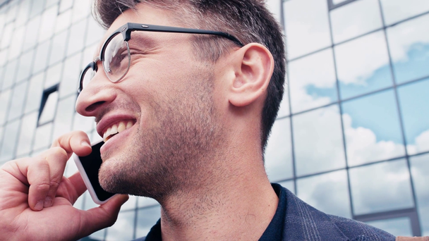 close up of happy man in glasses talking on smartphone outside - Footage, Video