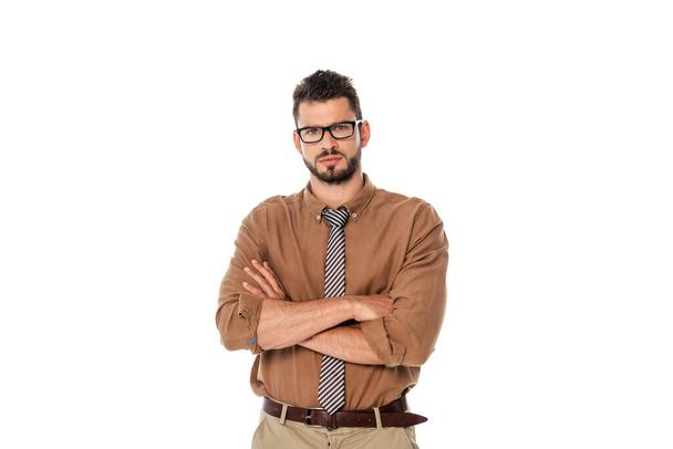 Serious teacher in eyeglasses with crossed arms looking at camera isolated on white - Photo, Image