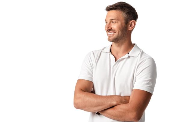 happy man in white t-shirt standing with crossed arms isolated on white  - Photo, Image