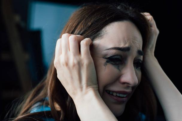 upset brunette woman with flowed mascara crying at home  - Photo, Image