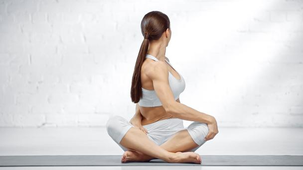 Brunette woman sitting in easy yoga pose  - Photo, Image