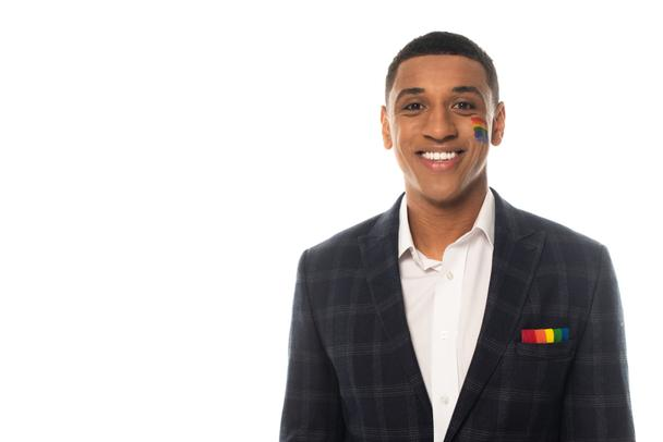 happy african american businessman with lgbt flag painted on face smiling at camera isolated on white - Photo, Image