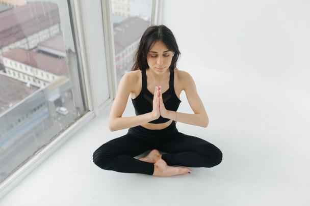 armenian woman meditating in lotus pose with praying hands and closed eyes - Photo, Image