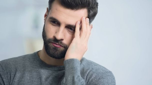 stressed and bearded man touching face at home - Photo, Image