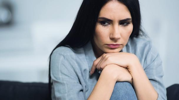 frustrated and brunette woman looking away at home  - Photo, Image