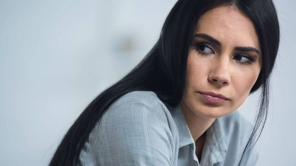 brunette and worried woman looking away at home  - Photo, Image
